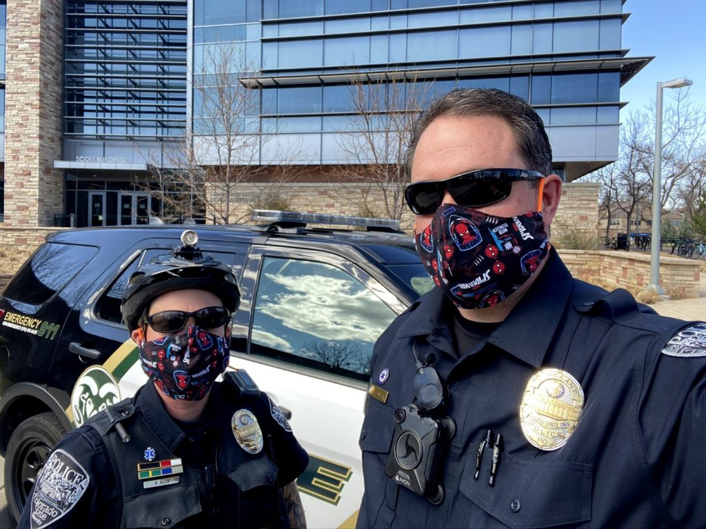 Officers wearing spider-man masks